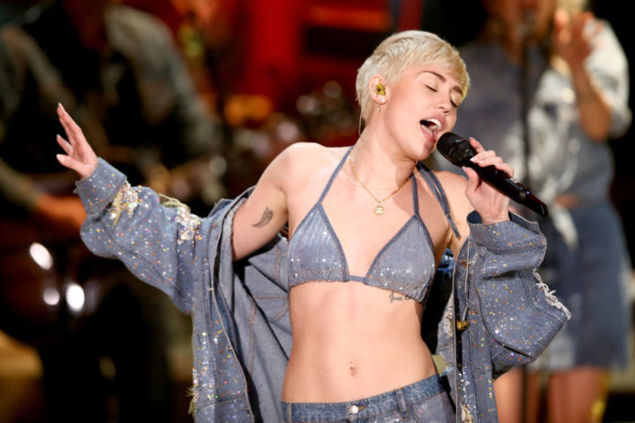 Miley Cyrus Launches Charity With Joan Jett Back Garden Performance Nme