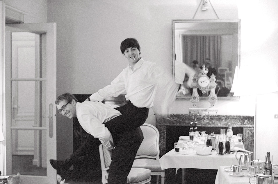 Paul McCartney and [tour manager] Mal Evans