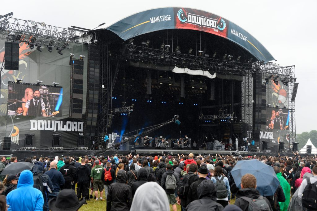 People gather around the main stage during the hard rock music Download festival in Paris on June 12, 2016. Download Festival gathers in the UK since 2003 fans of heavy guitars and powerful rock, but this year another edition is staged in Paris from June 10 to June 12, 2016. / AFP / BERTRAND GUAY (Photo credit should read BERTRAND GUAY/AFP/Getty Images)