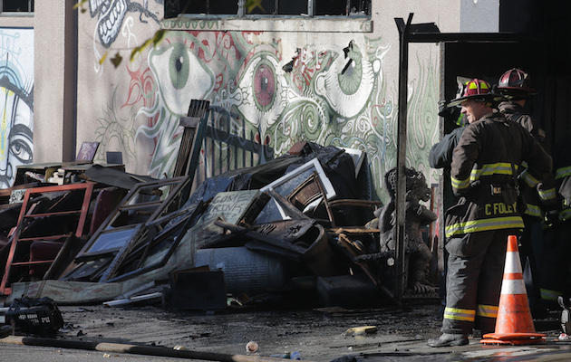 OAKLAND, CA - DECEMBER 03: Firefighters work at the scene following an overnight fire that claimed the lives of at least nine people at a warehouse in the Fruitvale neighborhood on December 3, 2016 in Oakland, California. The warehouse was hosting an electronic music party. (Photo by Elijah Nouvelage/Getty Imag