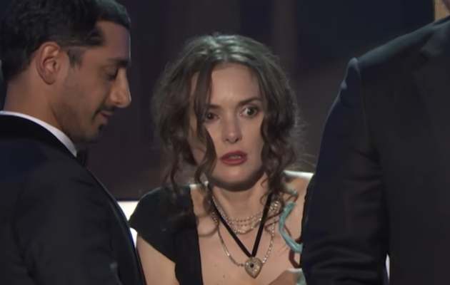 Winona Ryder listens to Stranger Things co-star David Harbour's speech at the SAG Awards 2017