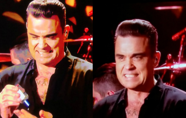 Robbie Williams washes hands