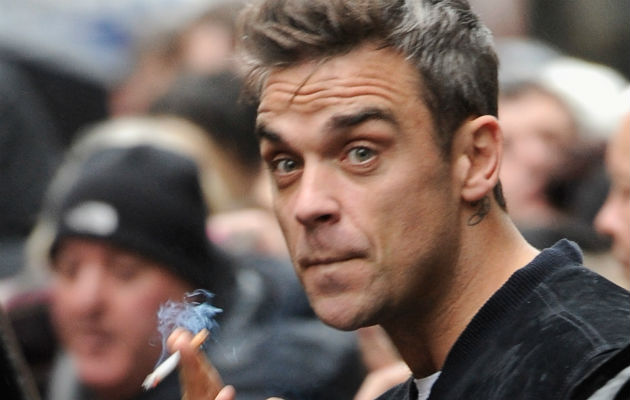 Robbie Williams says he smoked a spliff at Buckingham Palace