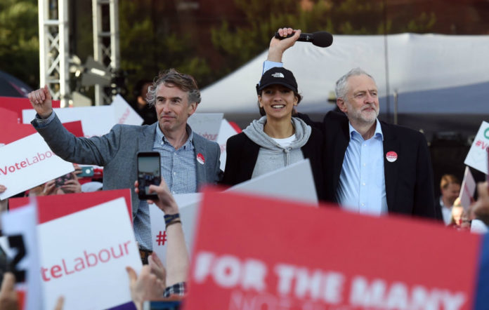 Labour Party leader Jeremy Corbyn (R) stands with comedian Steve Coogan (L) and supporter, Saffiyah Khan (C) at a campaign event in Birmingham