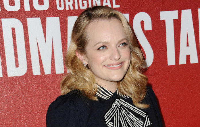 Elisabeth Moss has defended the controversial Church of Scientology