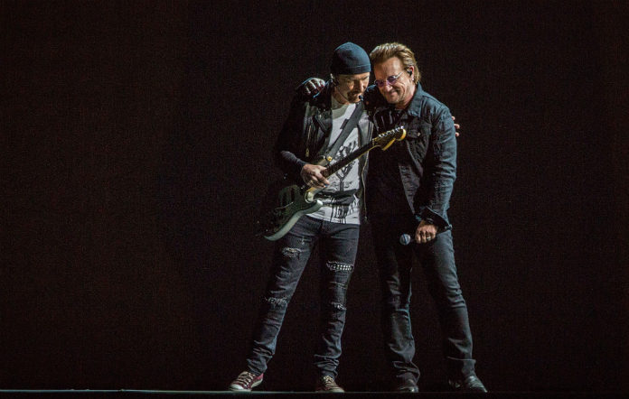 The Edge and Bono on stage with U2