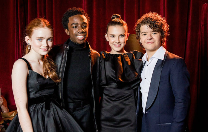 Millie Bobby Brown with the cast of 'Stranger Things' at the Golden Globes 2018