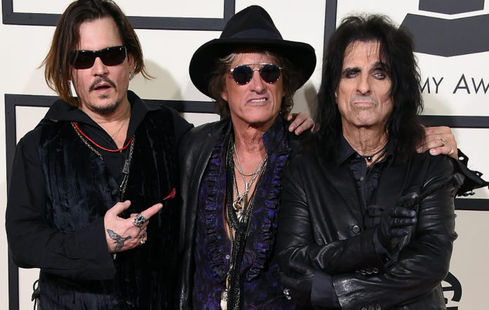 Johnny Depp, musician Joe Perry and musician Alice Cooper of music group The Hollywood Vampires attend The 58th GRAMMY Awards at Staples Center on February 15, 2016 in Los Angeles, California