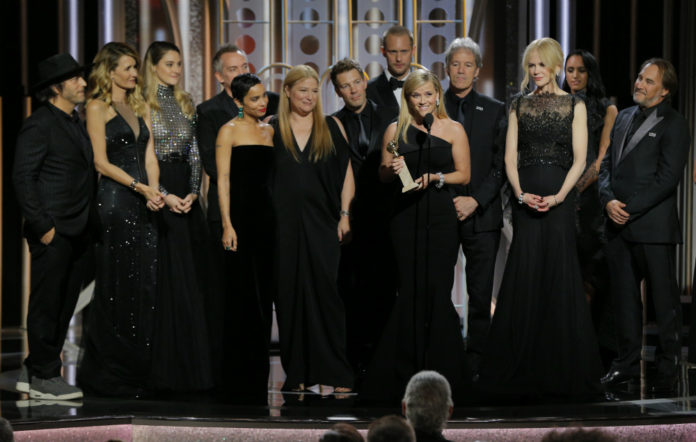 """Reese Witherspoon accepts the award for Best Television Limited Series or Motion Picture Made for Television for """"Big Little Lies"""" during the 75th Annual Golden Globe Awards at The Beverly Hilton Hotel on January 7, 2018 in Beverly Hills, California."""