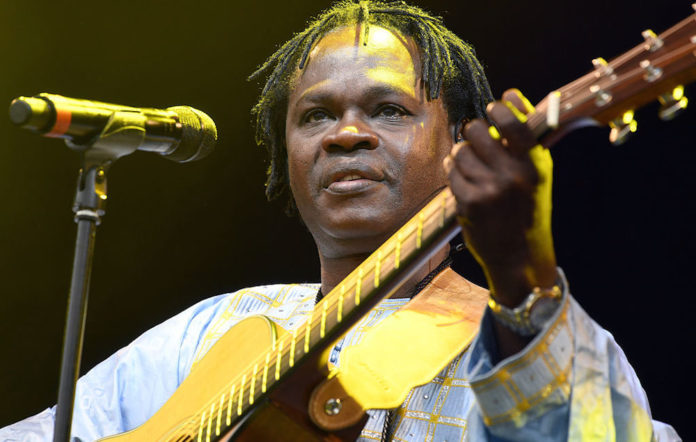 Baaba Maal performs on stage during Day 3 of the Womad Festival at Charlton Park on July 30, 2016