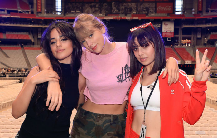Camila Cabello, Taylor Swift, and Charli XCX pose onstage before opening night of Taylor Swift's 2018 Reputation Stadium Tour