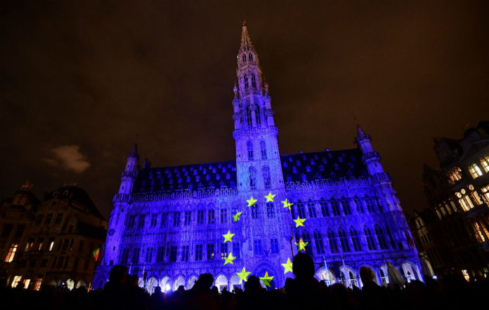 The European flag is projected onto the town hall at the Grand Place in Brussels