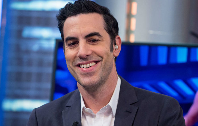 Sacha Baron Cohen extended clip arming toddlers