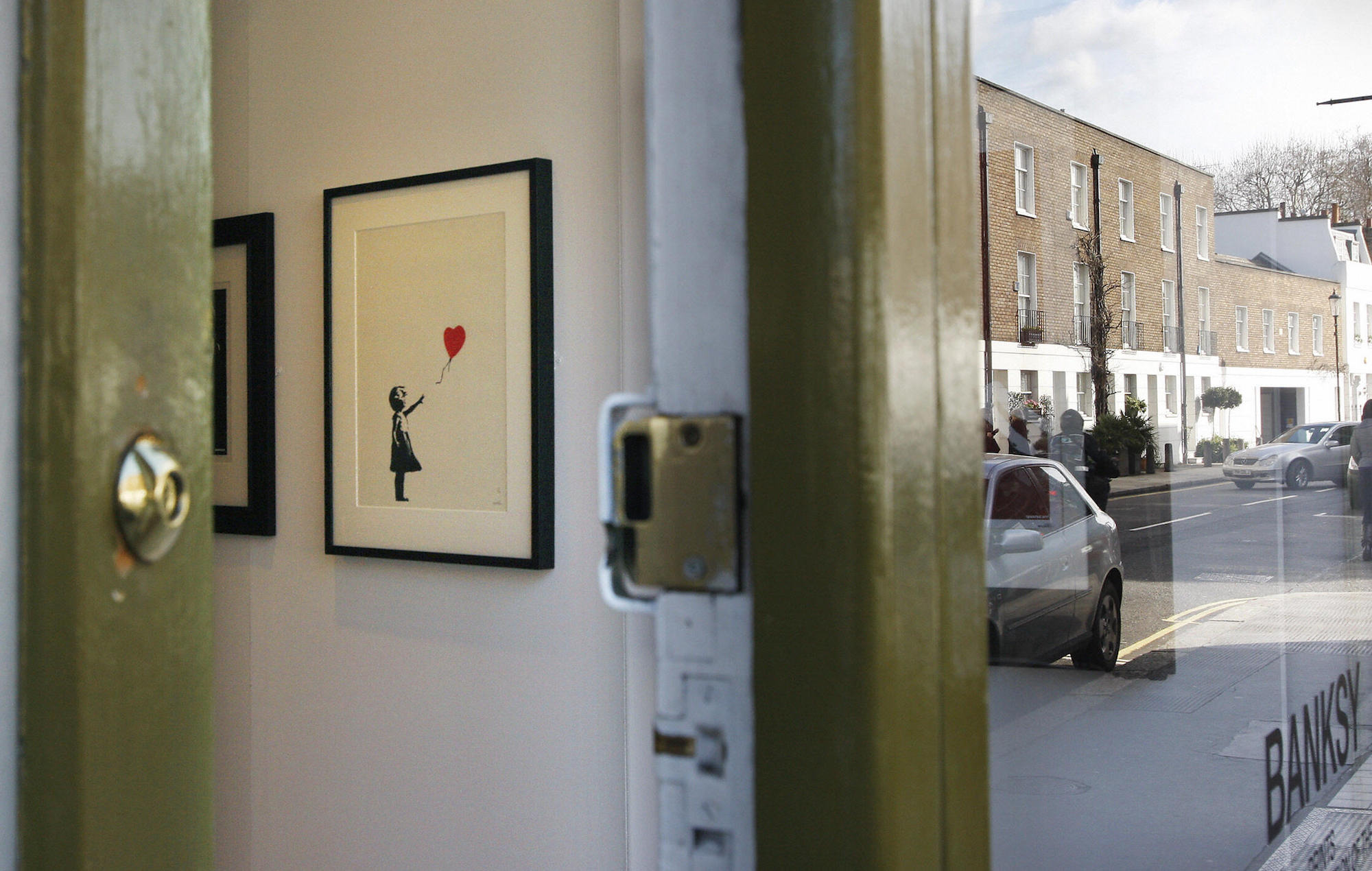 """Banksy's self destructing painting """"doubles in value"""" after selling for $1.1 million - but were Sotheby's involved?"""