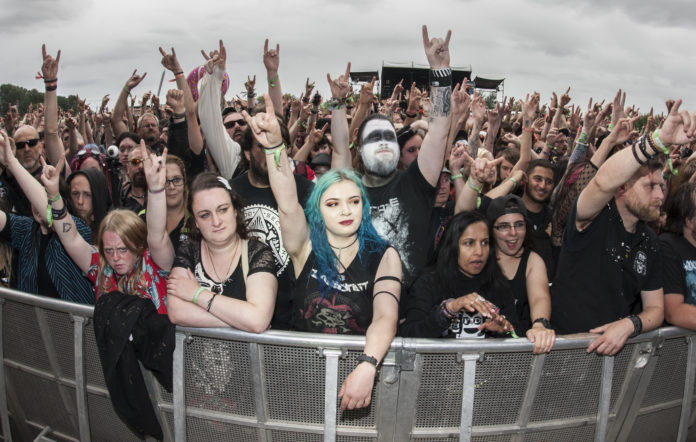 BURTON UPON TRENT, ENGLAND - AUGUST 11: Heavy metal fans at Bloodstock Festival at Catton Hall on August 11, 2018 in Burton Upon Trent, England. (Photo by Katja Ogrin/Redferns)