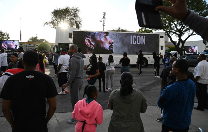 Mourners line the route of Nipsey Hussle's funeral procession
