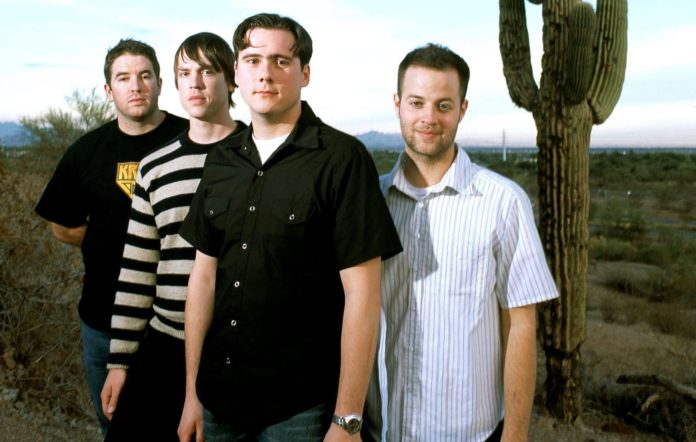 Jim Adkins, Rick Burch ; Zac Lind, Tom Linton of Jimmy Eat World, group portrait, Colorado, United States, 2001. (Photo by Martyn Goodacre/Getty Images)