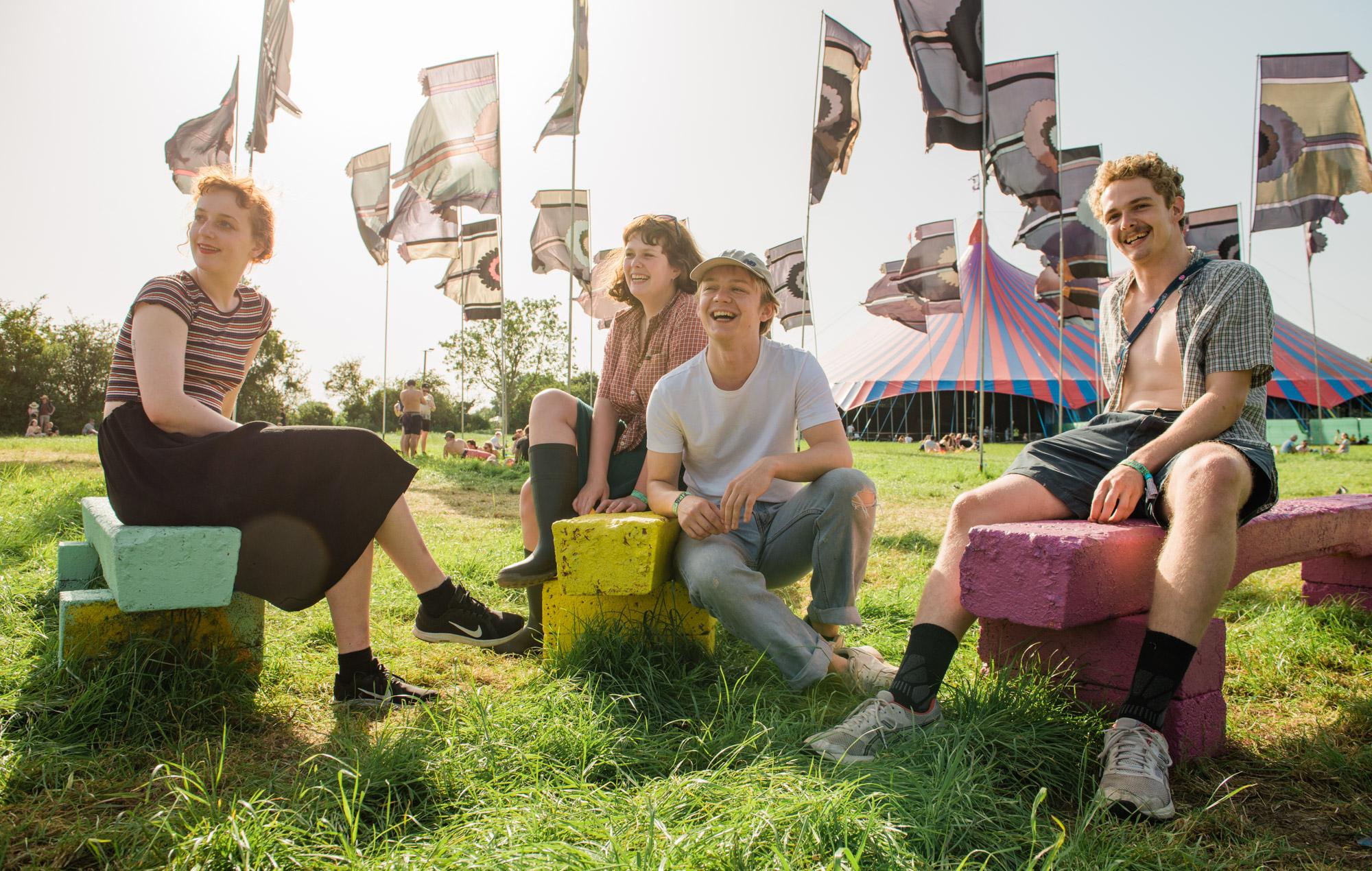Pip Blom relax at Glastonbury festival