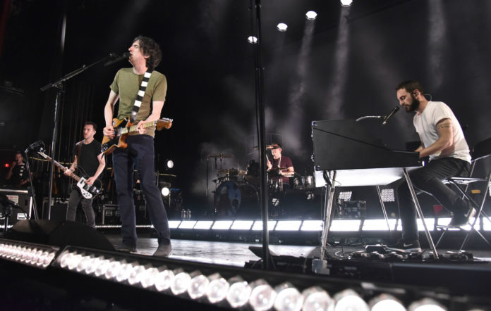 (L-R) Paul Wilson, Gary Lightbody, Jonny Quinn, and Johnny McDaid of Snow Patrol perform in support of the band's