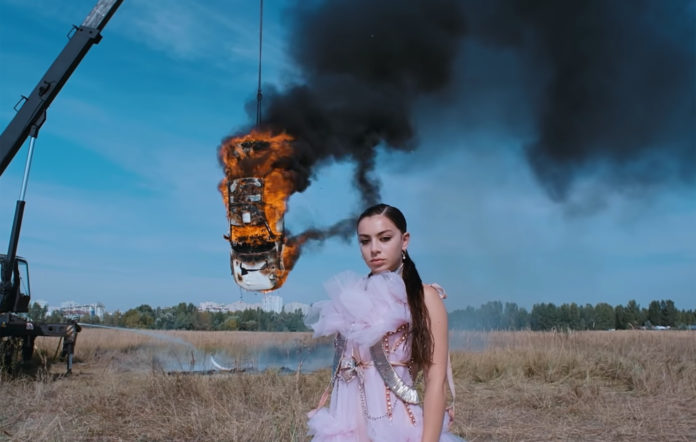 Charli XCX responds to air pollution clams in White Mercedes MV
