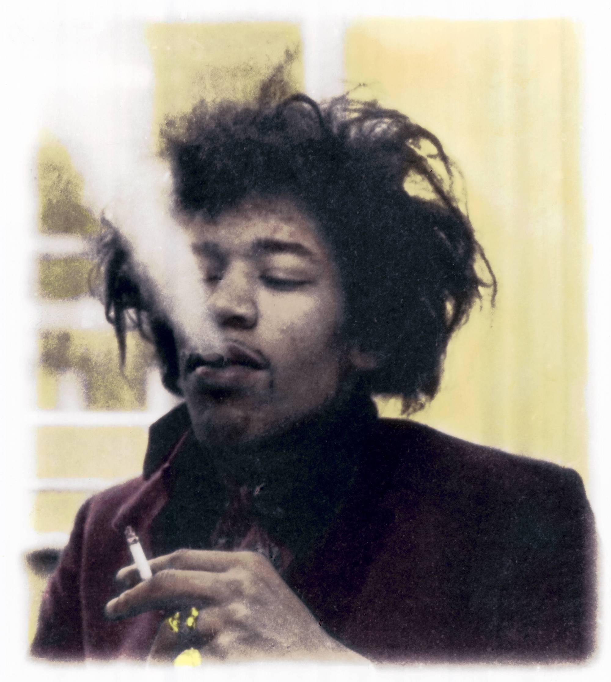 Photo of Jimi HENDRIX; posed, smoking cigarette