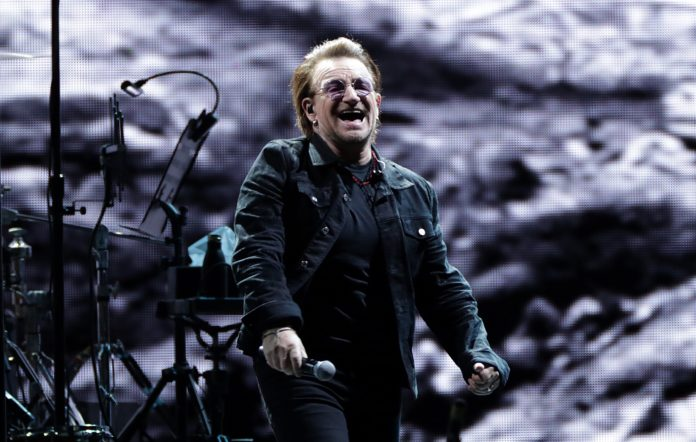 Bono of U2 performs on stage during U2's 'The Joshua Tree Tour'