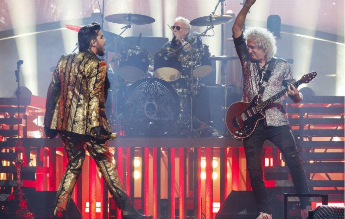 Adam Lambert, Roger Taylor and Brian May of Queen + Adam Lambert perform
