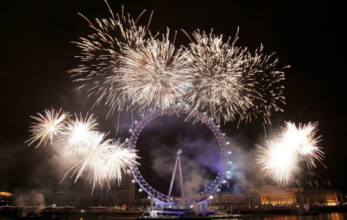 Fireworks explode over the River Thames