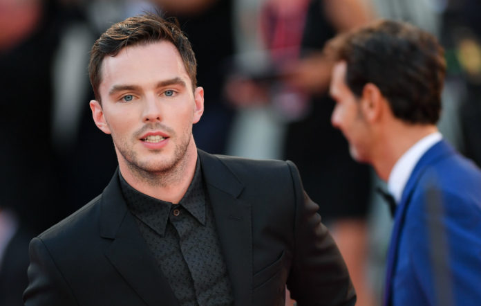 Nicholas Hoult walks the red carpet ahead of the