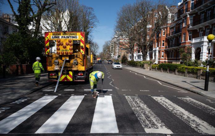 Abbey Road is repainted during London's lockdown