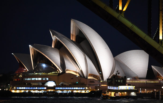 The Sydney Harbour Bridge and Opera House at night, Sydney, Australia