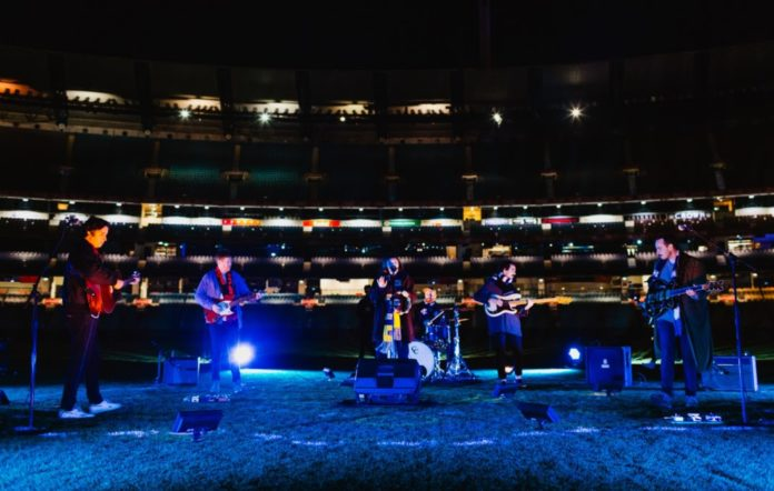 Rolling Blackouts Coastal Fever perform with Stella Donnelly at an empty MCG