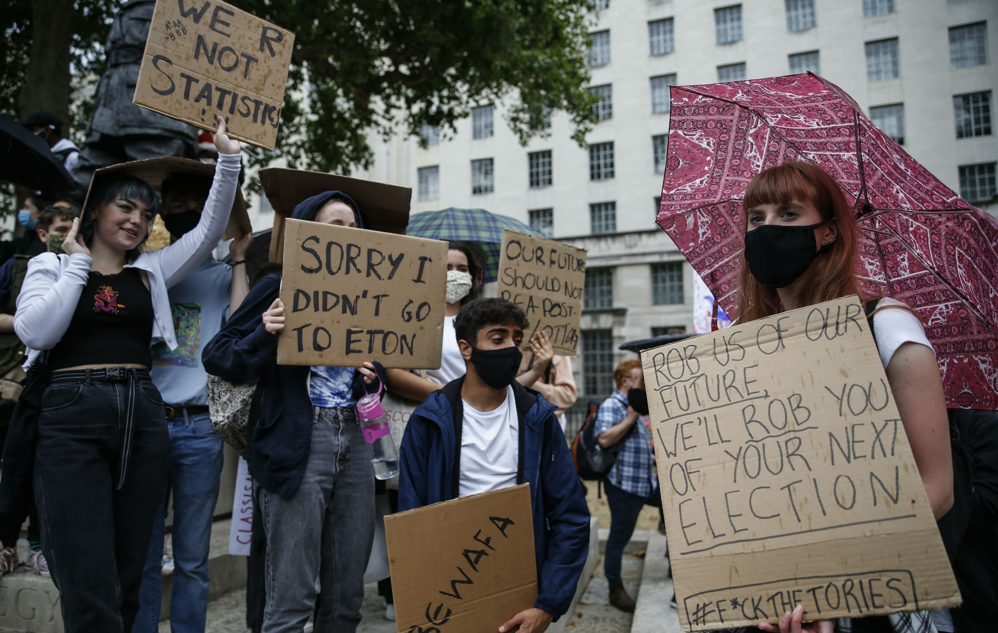 Students take part in an A-Level results protest opposite Downing Street