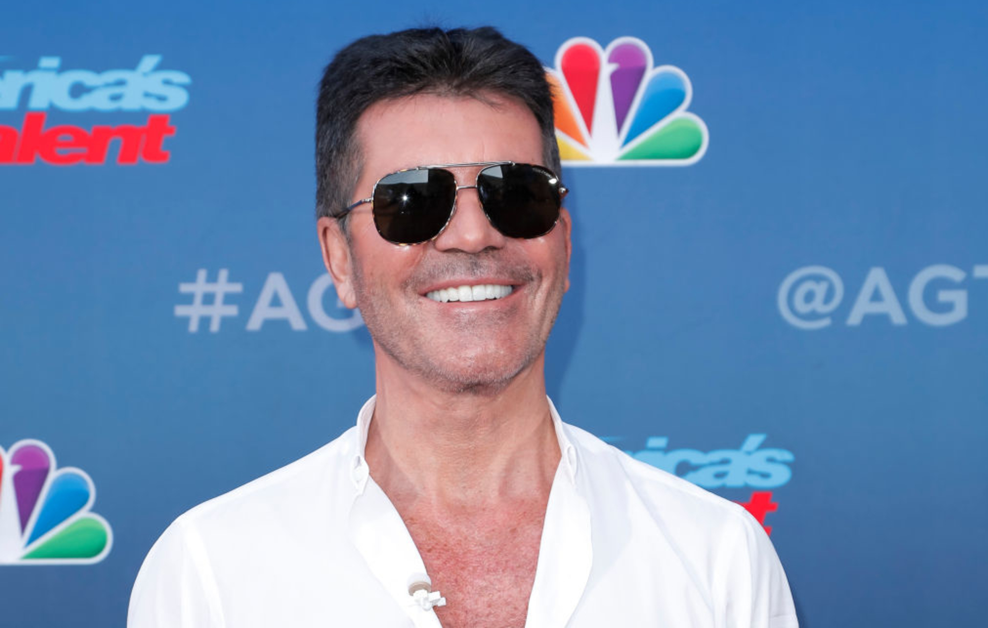 Simon Cowell hospitalised after breaking his back falling off bike