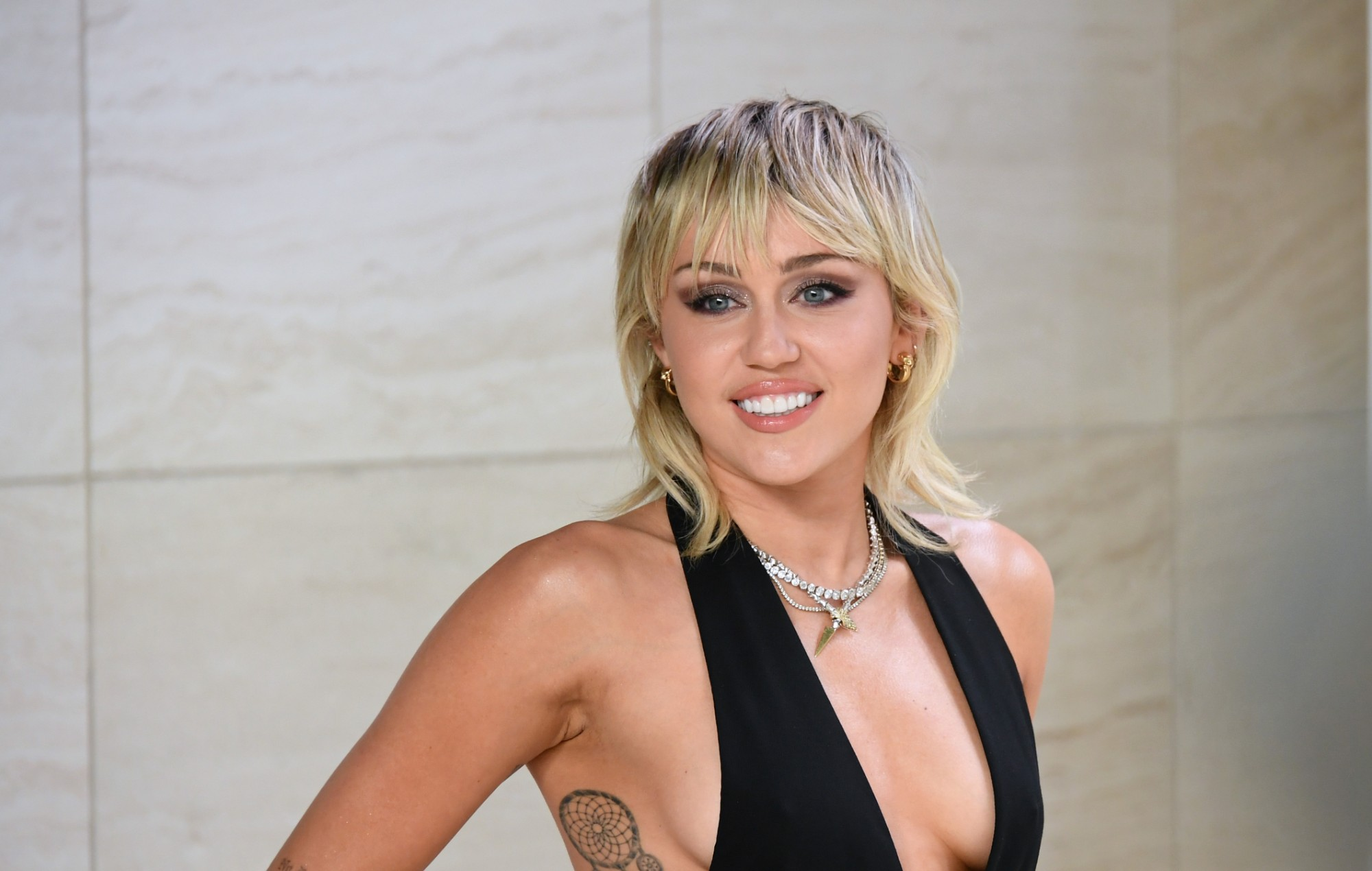 Miley Cyrus teases new music as she tells fans to 'Meet