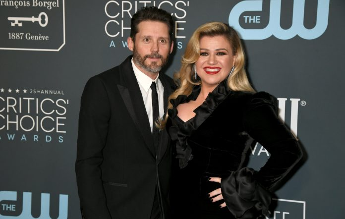 Kelly Clarkson is being sued by her management firm