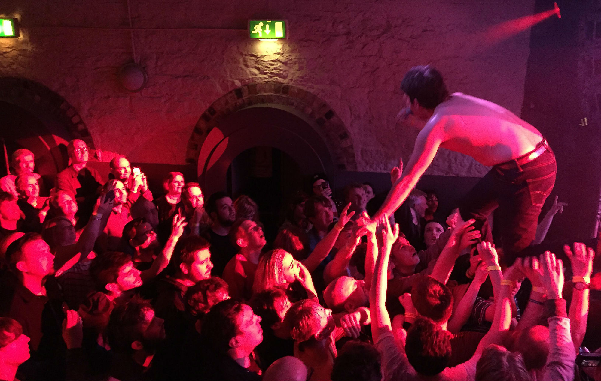 Crowdsurfing at a grassroots venue. Credit Brookfield / Stockimo / Alamy Stock Photo