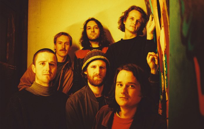 King Gizzard Lizard Wizard KG album microtonal interview Joey Walker Eric Moore leaves band
