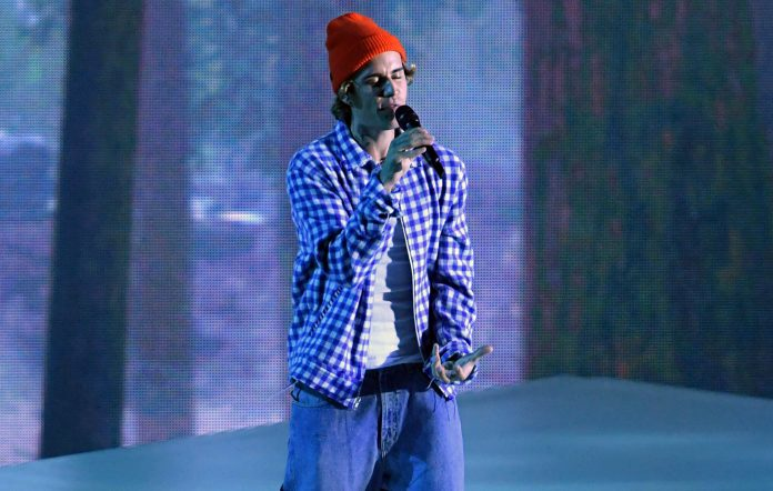 Justin Bieber performs onstage for the 2020 American Music Awards