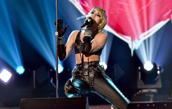 Miley Cyrus performs on-stage in leather outfit