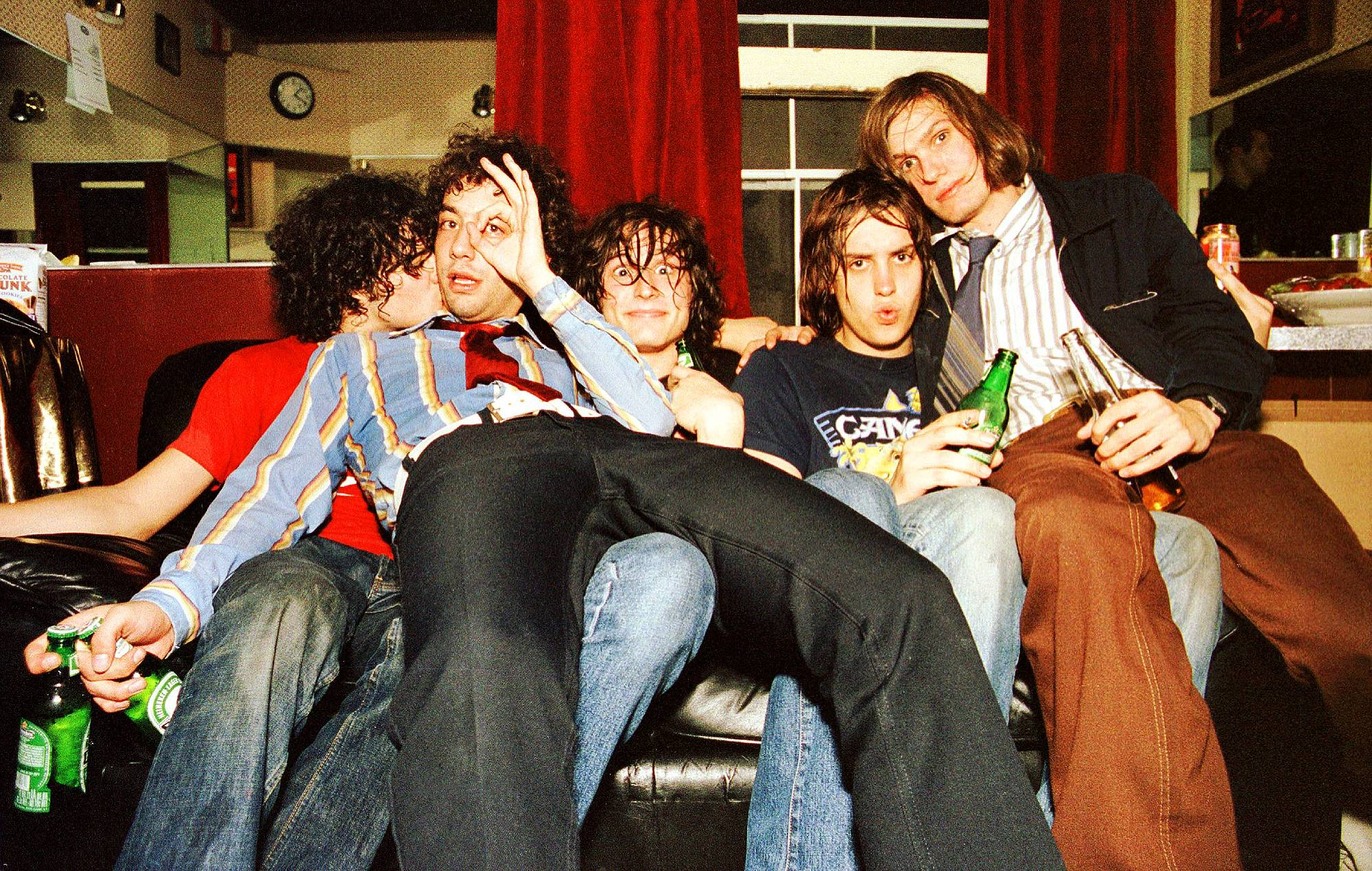 Portrait of The Strokes backstage at The Fillmore, San Francisco, California, USA on 16th October 2001, L-R Fabrizio Moretti, Albert Hammond Jr, Nick Valensi, Julian Casablancas and Nikolai Fraiture. (Photo by Anthony PIdgeon/Redferns)