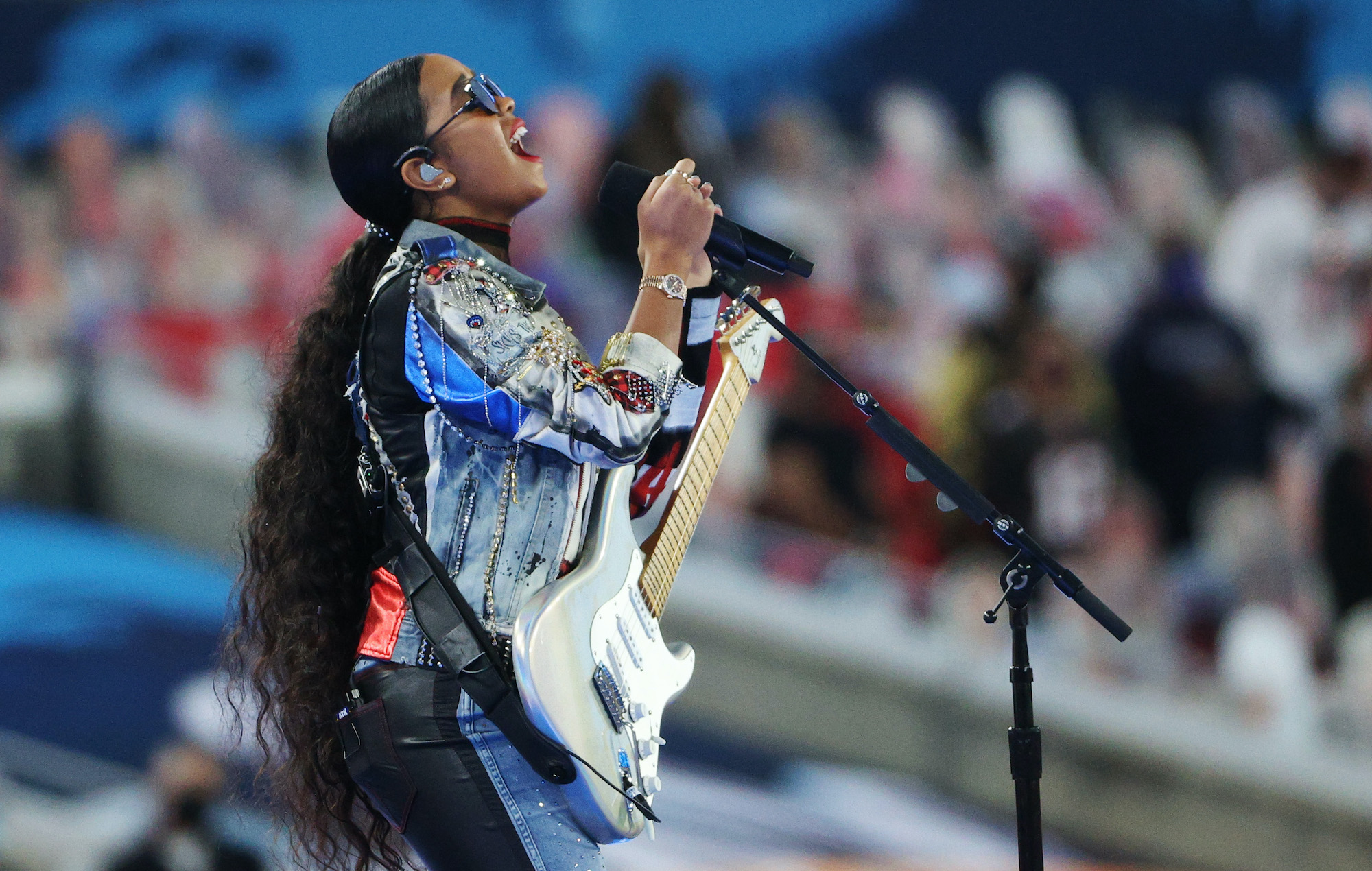 Watch H.E.R. perform 'America The Beautiful at Super Bowl 2021