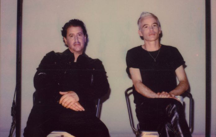 The Avalanches sitting side by side in a polaroid