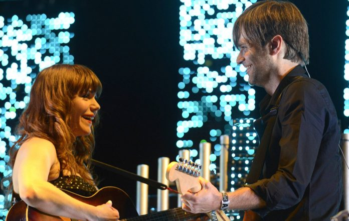 Jenny Lewis (L) and Ben Gibbard of The Postal Service perform as part of the 2013 Coachella Valley Music & Arts Festival at the Empire Polo Field on April 20, 2013 in Indio, California. (Photo by Tim Mosenfelder/WireImage)