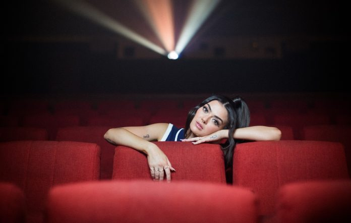 Charley draped across seats in an empty move theatre