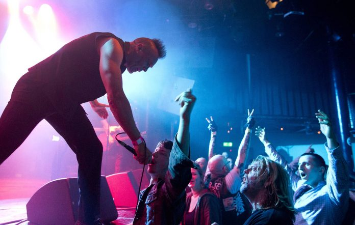 John Robb performs on stage with Goldblade at the Punk Rebellion festival, Melkweg, Amsterdam, Netherland (Photo by Paul Bergen/Redferns)
