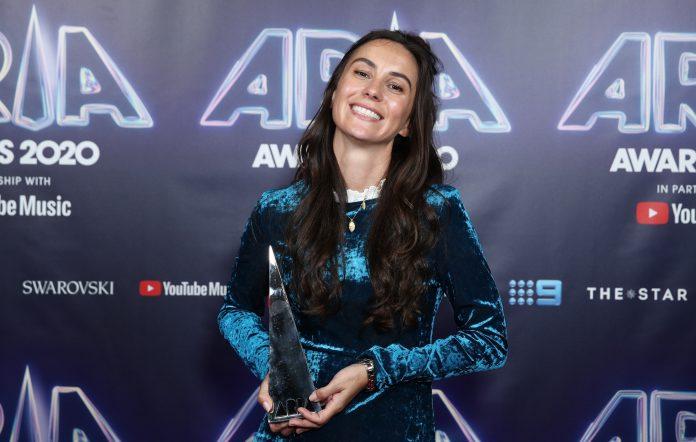 Amy Shark holding ARIA Award 2020