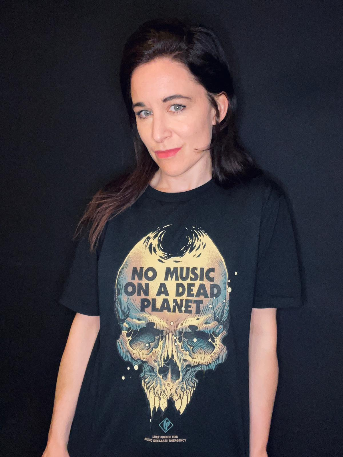 Music Declares Emergency founder Fay Milton of Savages in a new No Music On A Dead Planet t-shirt