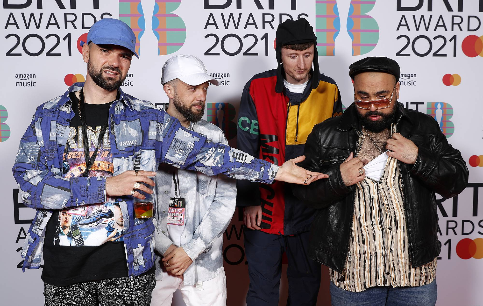 Allan Mustafa, Hugo Chegwin, Steve Stamp and Asim Chaudhry aka Chabuddy G of Kurupt FM pose in the media room at The BRIT Awards 2021 at The O2 Arena on May 11, 2021 in London, England. (Photo by JMEnternational/JMEnternational for BRIT Awards/Getty Images)