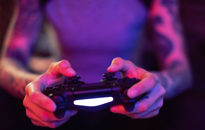Woman playing PS4 game
